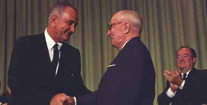 President Johnson shaking hands with former President Harry Truman.
