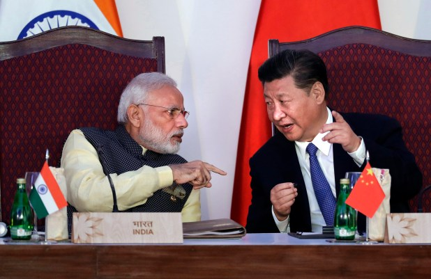 Indian leader Narendra Modi points finger during conversation with China's Xi Jinping.