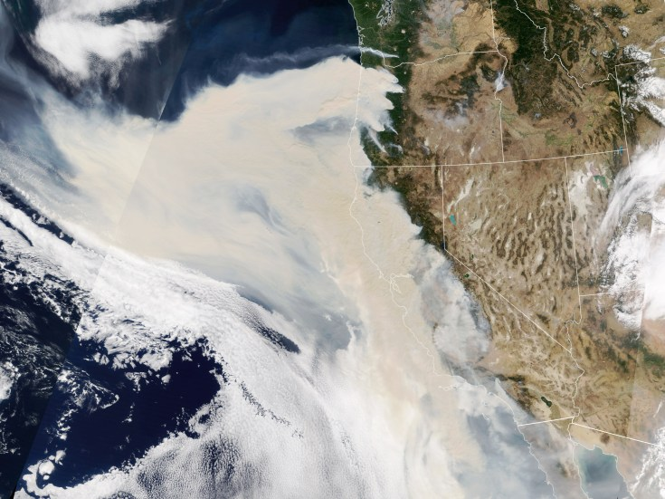 Satellite image of smoke drifting off the Pacific coast from California and Oregon.
