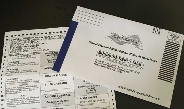 A mail-in election ballot partially obscured by its envelope
