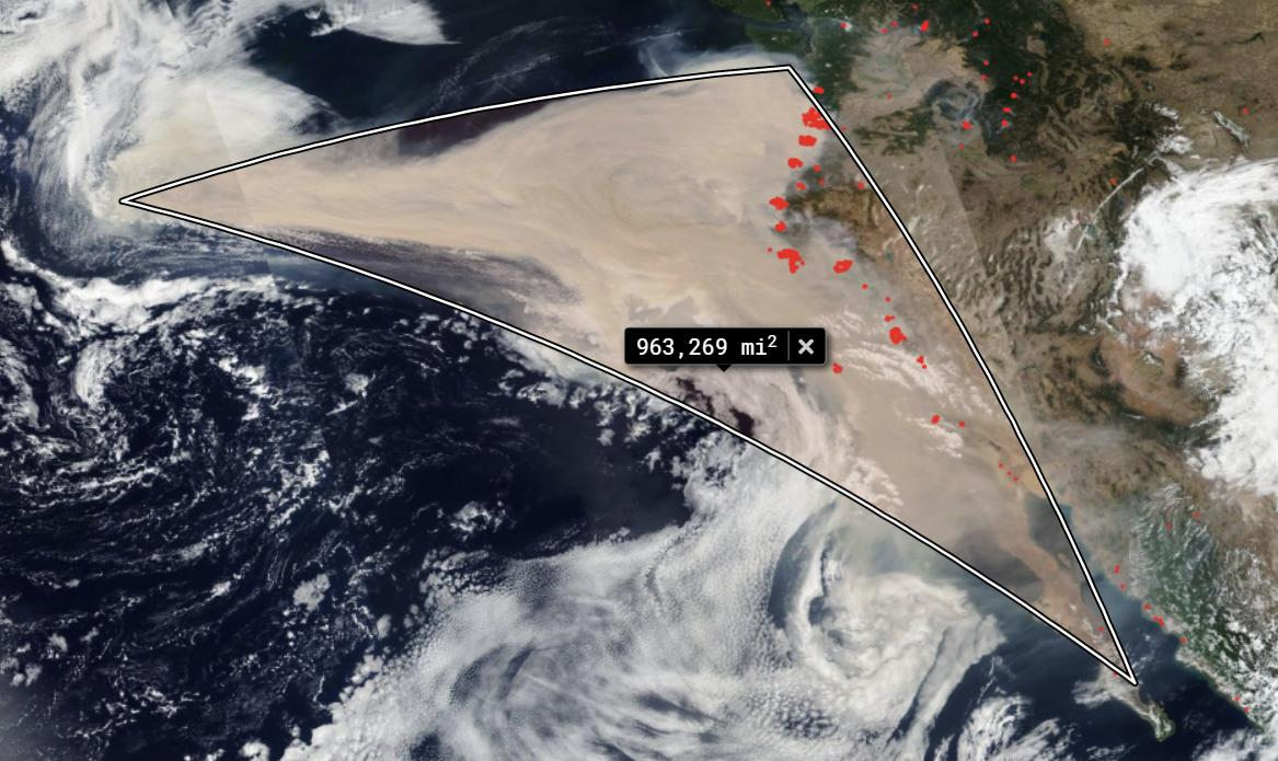 Brown smoke spreads over the Pacific from U.S. west coast.