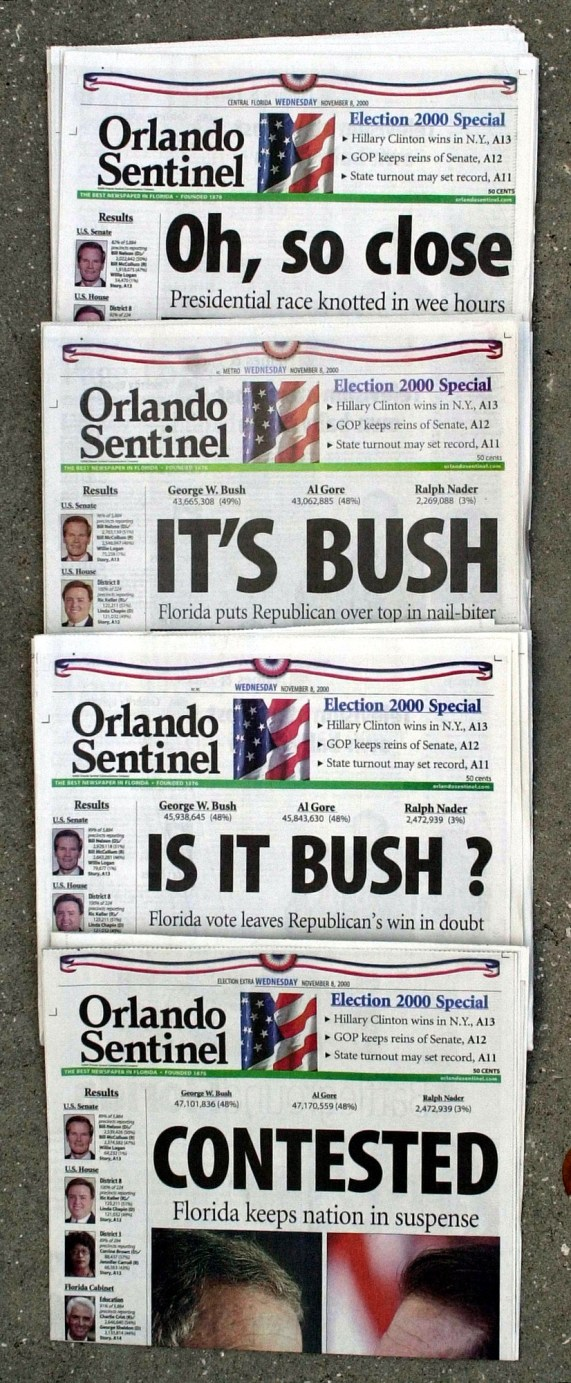 Several Orlando Sentinel newspapers with headlines 'Oh, So Close,' 'It's Bush,' 'Is it Bush?' and 'Contested.'