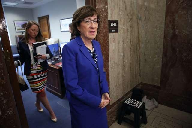 Sen. Susan Collins in a marine blue suit.