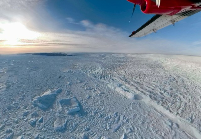An aerial view of the edge of the large Jakobshvan Glacier, where ice breaks off into the sea.