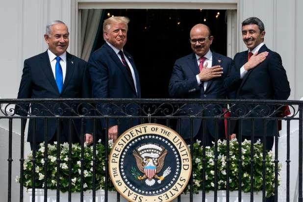Israeli Prime Minister Benjamin Netanyahu, left, President Donald Trump, Bahrain Foreign Minister Khalid bin Ahmed Al Khalifa and United Arab Emirates Foreign Minister Abdullah bin Zayed al-Nahyan stand together on a balcony.