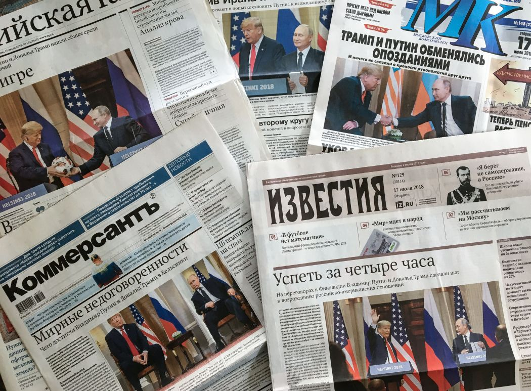 Front pages of Russia's main newspapers featuring pictures of the 2018 summit between Donald Trump and Russian President Vladimir Putin in Helsinki, Finland.