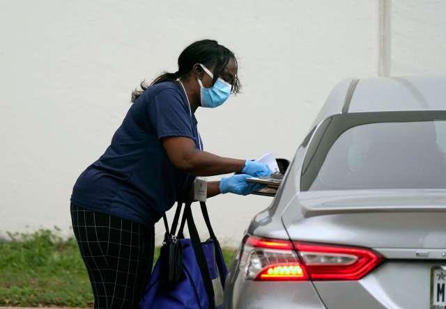 A Texas voter drops off an absentee ballot