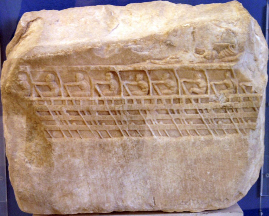 An ancient carving showing a Trireme showing three levels of rowers.