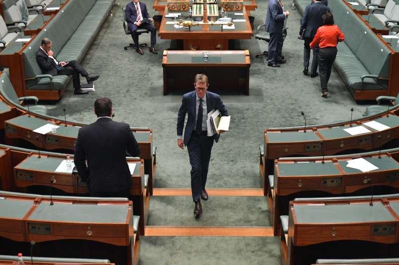 AG Christian Porter walks in the House of Reps.