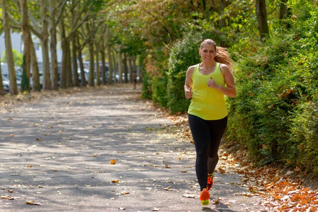 A woman runs in the park.