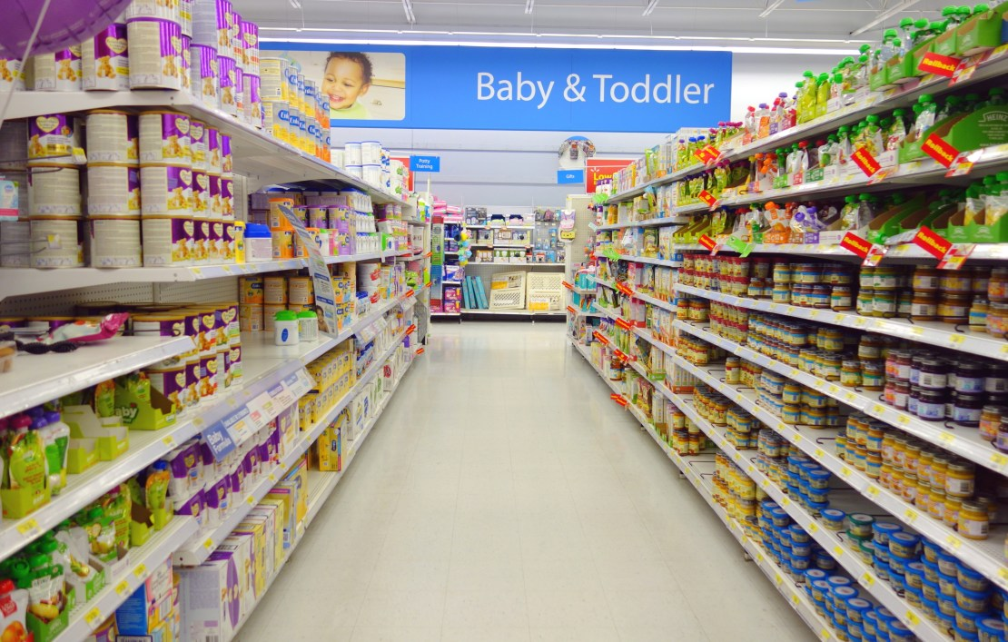 A grocery store aisle full of baby and toddler formula products.