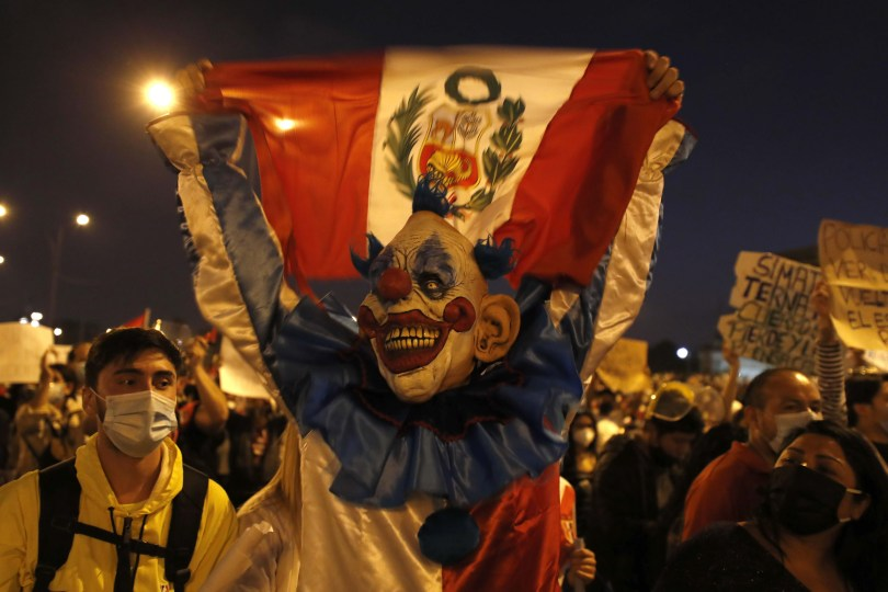Man dressed as clown protesting on the streets of Lima, November 2020.