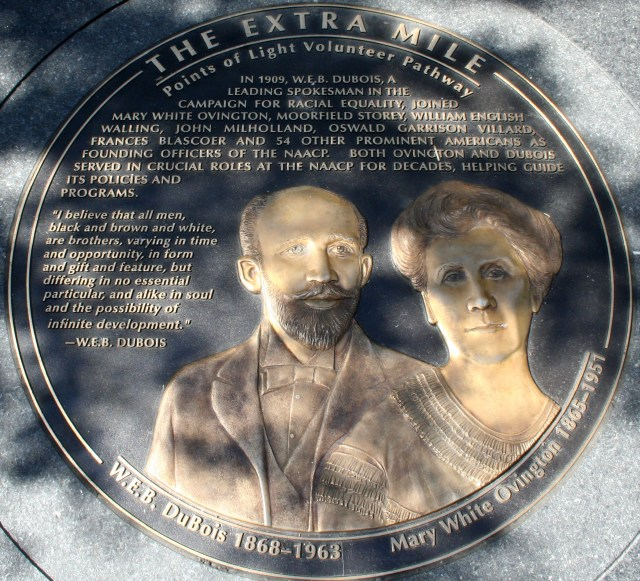 A medallion monument of a Black man and a white woman