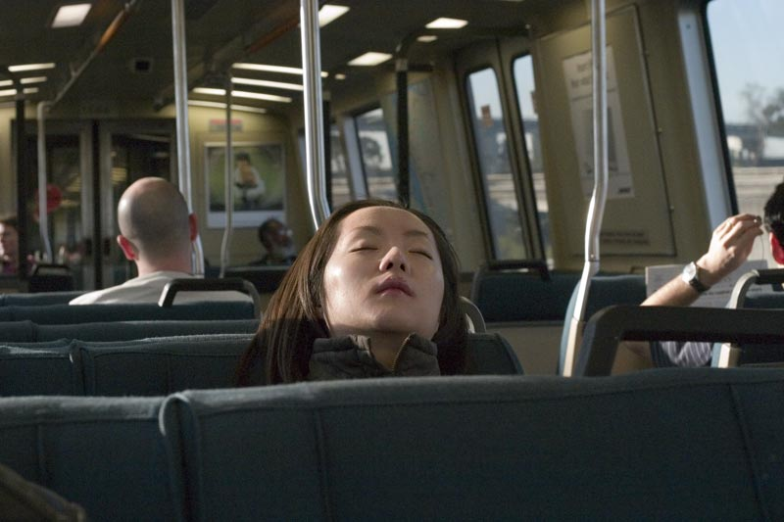 Woman sleeping on the bus.