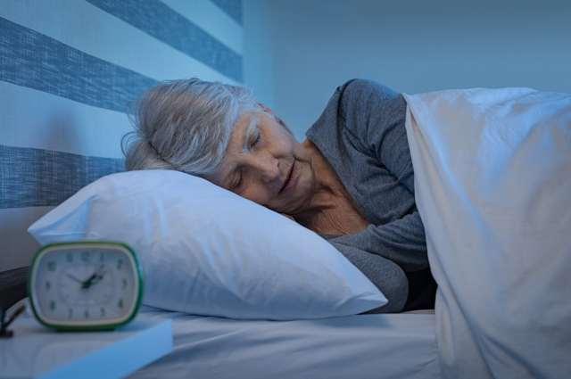 An elderly lady in bed sleeping