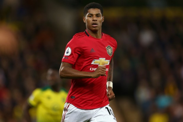 Manchester United player Marcus Rashford running on the pitch.
