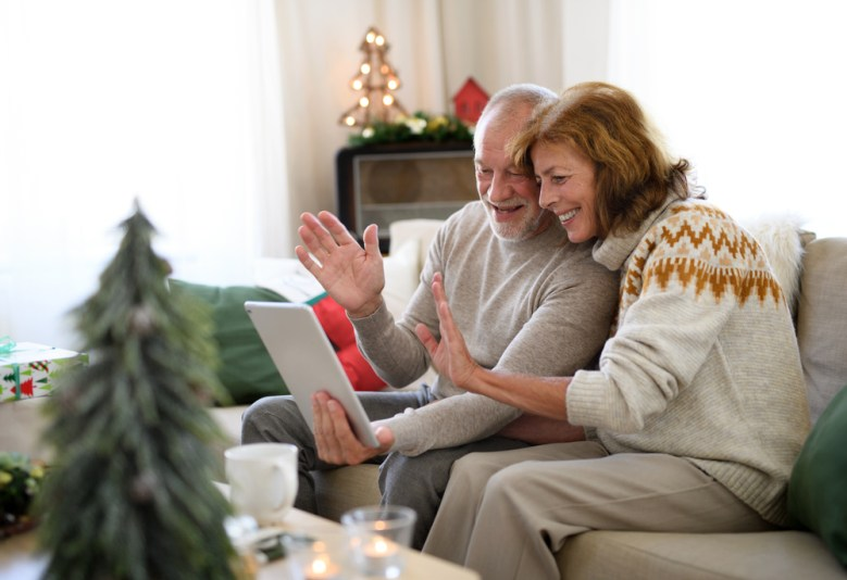 An older couple celebrating Christmas over Zoom with family