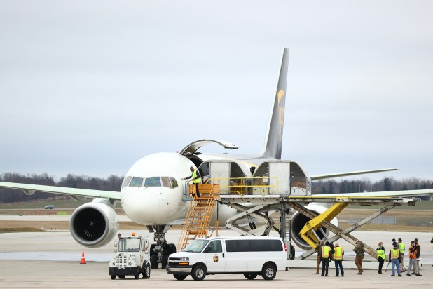 Covid-19 vaccine is loaded on to airplane.