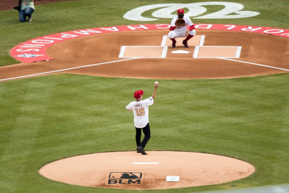 Fauci throws out a pitch at an MLB stadium