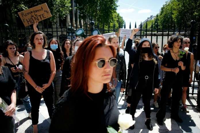 Women dressed in black protest in Paris
