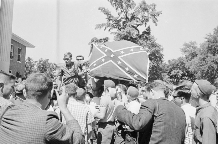 University of Mississippi students hold a Confederate battle flag