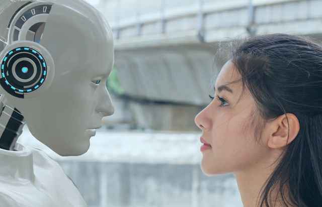 Human woman and robot stare at each other.
