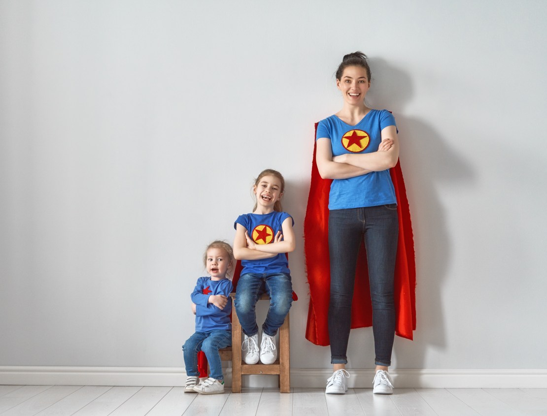 Image of a mum and two kids dressed as superheroes.