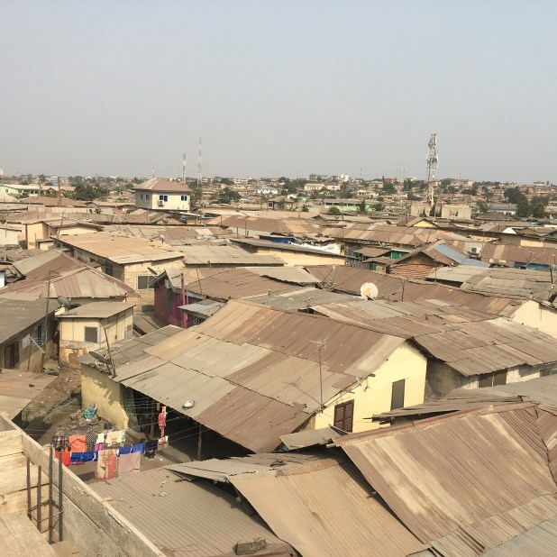 A view of metal rooftops in an urban community in Ghana.