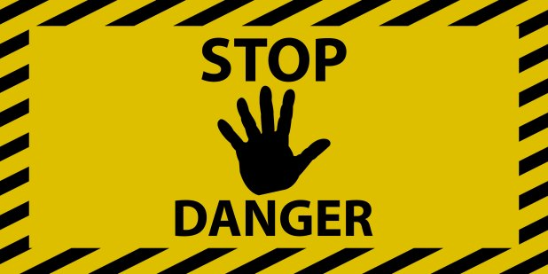 A yellow and black 'stop danger' sign.