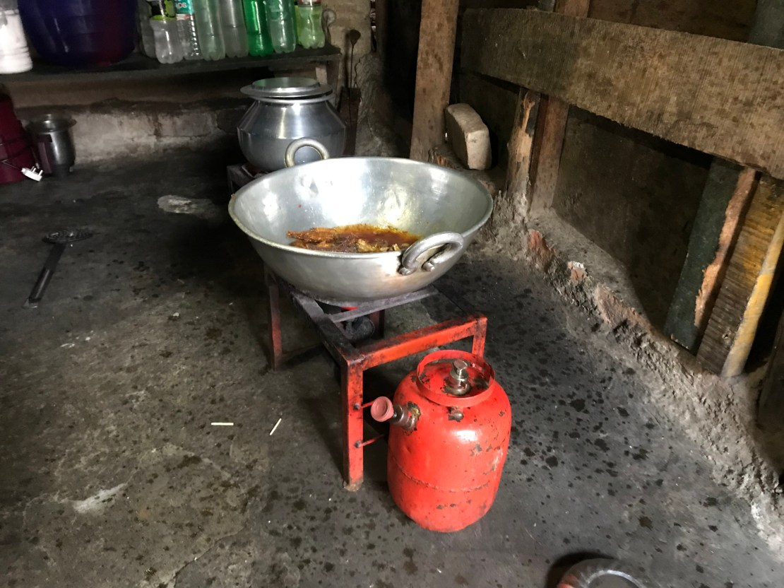 A pot of stew cooking over a stove.