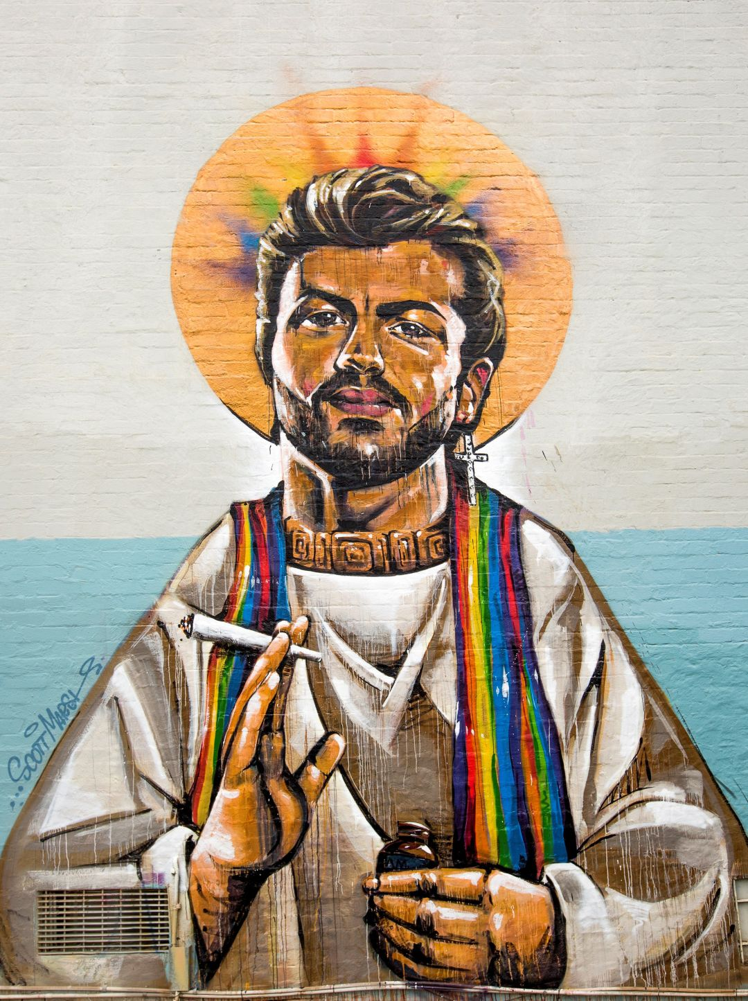 George Michael in priestly robes with a cross dangling from one ear, his head surrounded by a rainbow-coloured halo and smoking marijuana