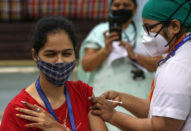 A woman received a COVID vaccine in India.
