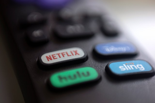 A television remote control with button labelled Netflix, Hulu, Disney+ and Sling