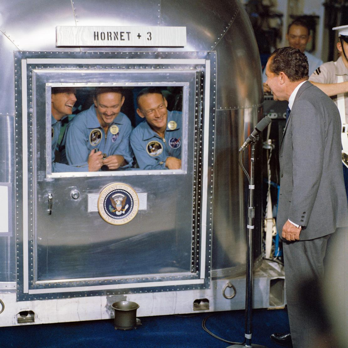 Image of President Nixon welcoming astronauts aboard the U S S Hornet.