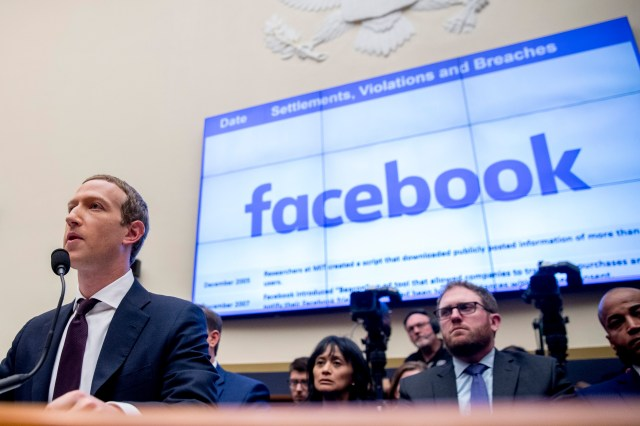 Facebook CEO Mark Zuckerberg speaks into a microphone at a House committee hearing in 2019