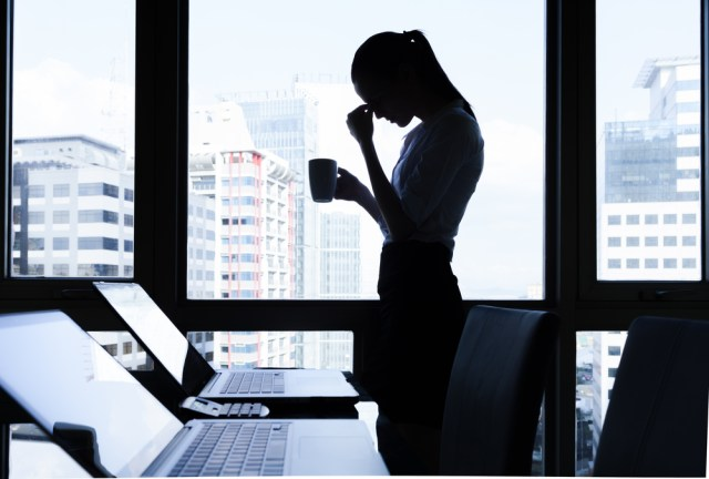 Woman stressed and isolated at work