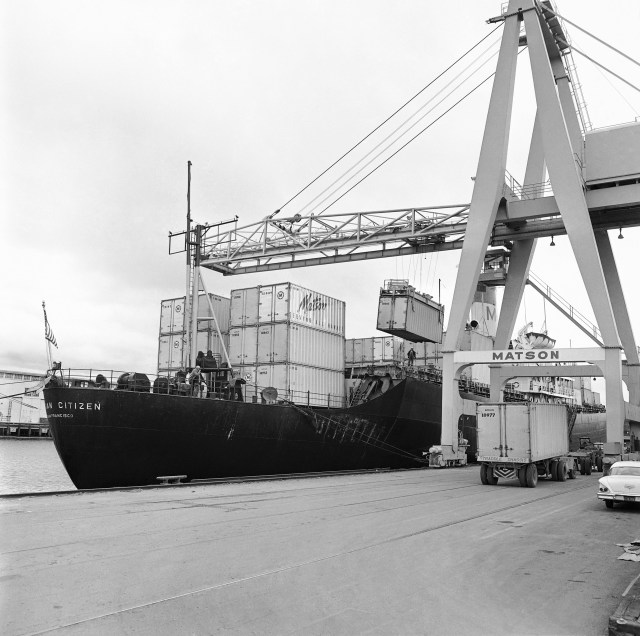 Cranes load containers onto a ship at the San Francisco pier in 1963.