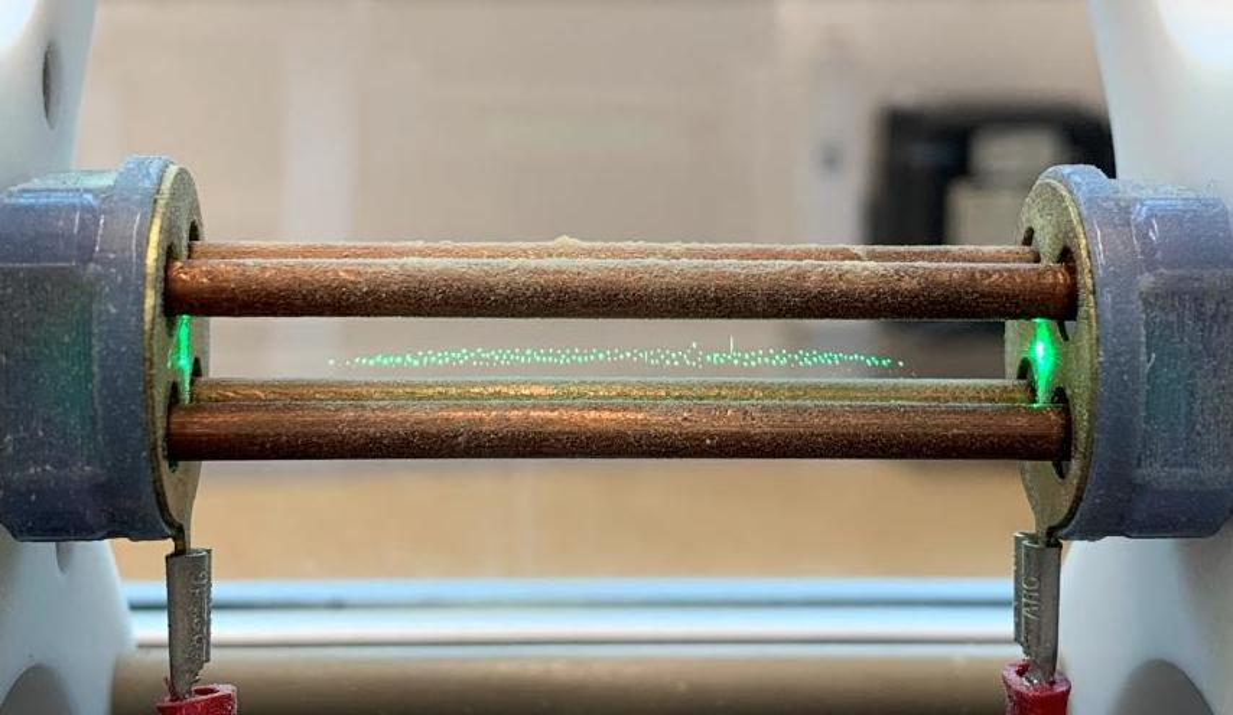 Four electrodes around a laser