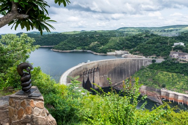 A hydroelectric dam surrounded by a lush green scenery.