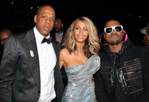 Three hip-hop celebrities attend an event.
