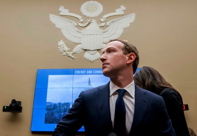 Facebook CEO Mark Zuckerberg looks to his right during a hearing on Capitol Hill in 2019