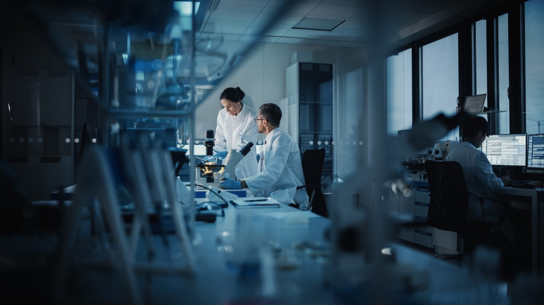 Three scientists at work in a lab