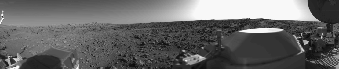 A panoramic view of Mars in black and white.