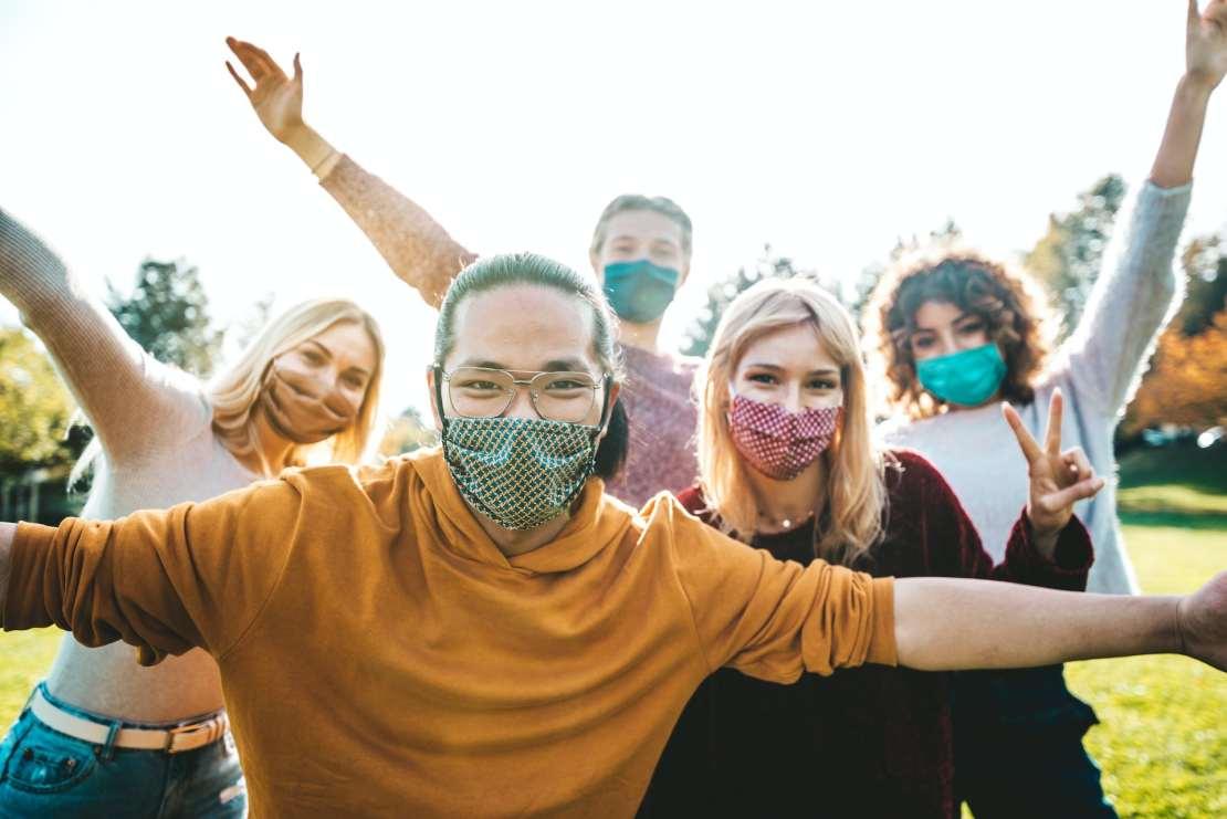 People wearing face masks outside socialising