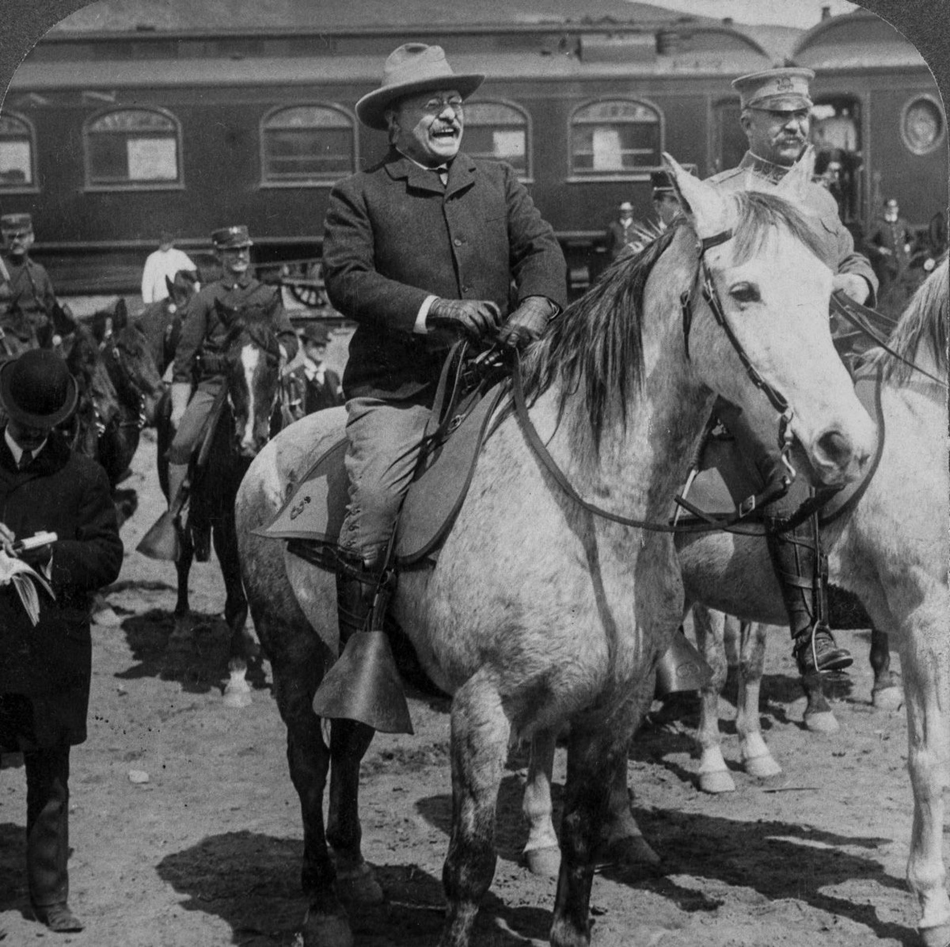 Roosevelt on horseback looking elated.