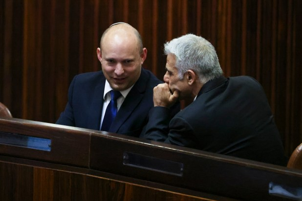 Naftali Bennett and Yair Lapid, the new Israeli coalition leaders, in close conversation.