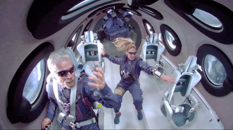 Two people in space suits attain zero gravity.