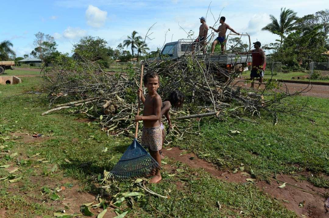children rake branches