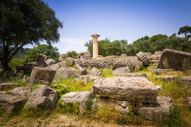 Ruins surround a lone pillar.