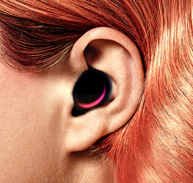 A close-up of a person's ear including a listening device